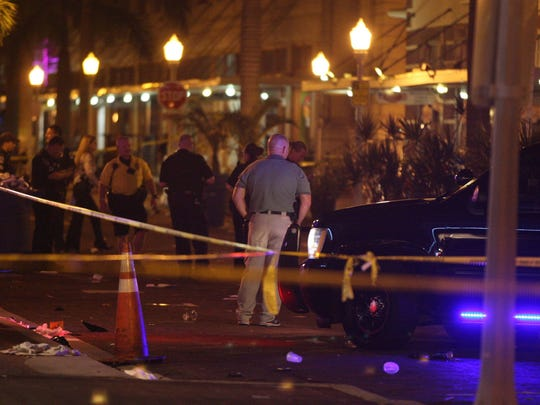 Fort Myers police investigate the scene of a deadly shooting, which left one man dead and five others injured in October at the annual Zombicon event downtown. The shooter has not been found.