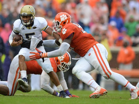 Clemson defensive end Shaq Lawson gets a grip on Georgia Tech quarterback Justin Thomas.