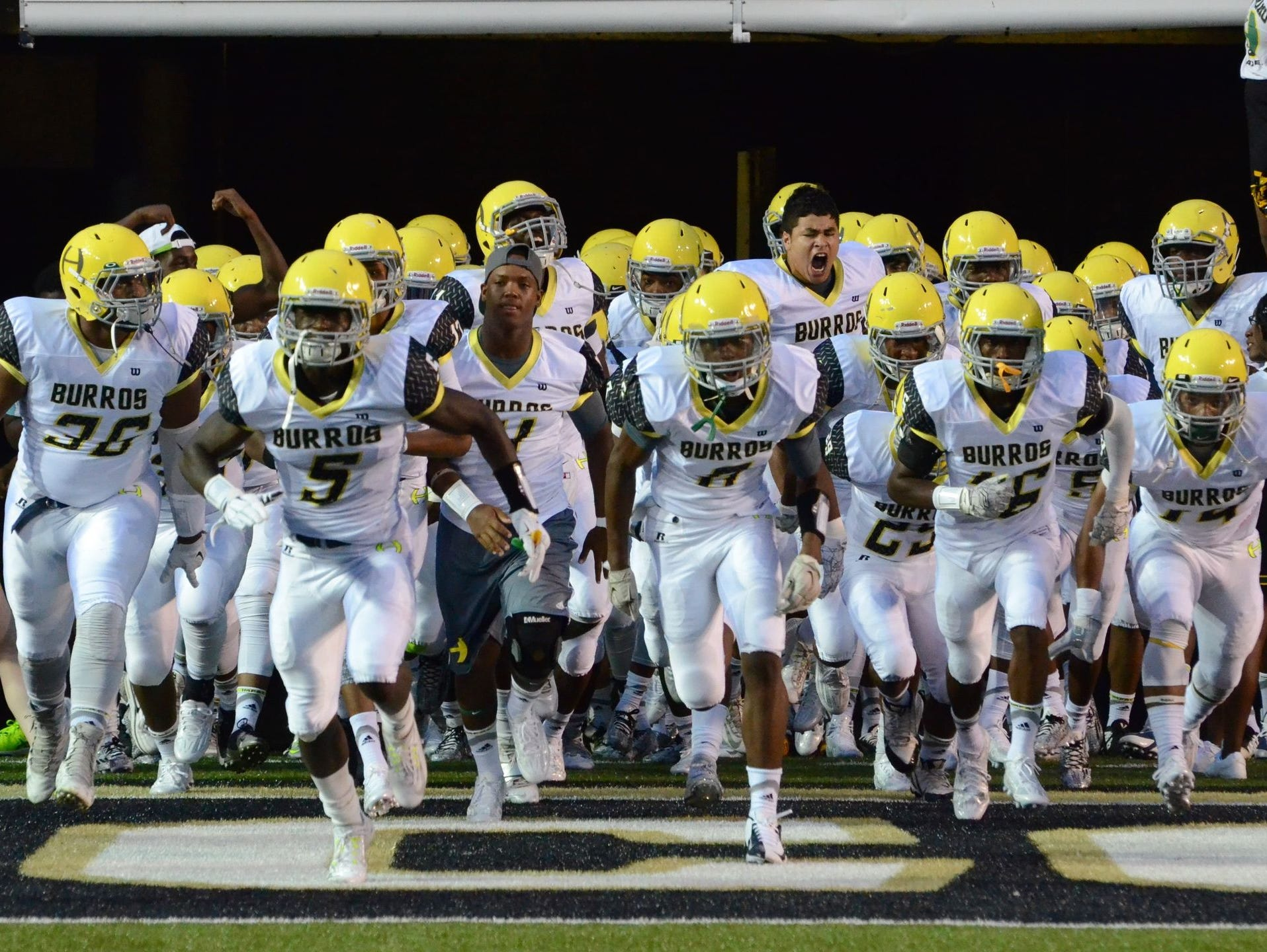 Hillsboro takes the field prior to its Week 1 win over Pearl-Cohn.