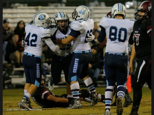 Redwood's Jayden Sullivan celebrates a sack against