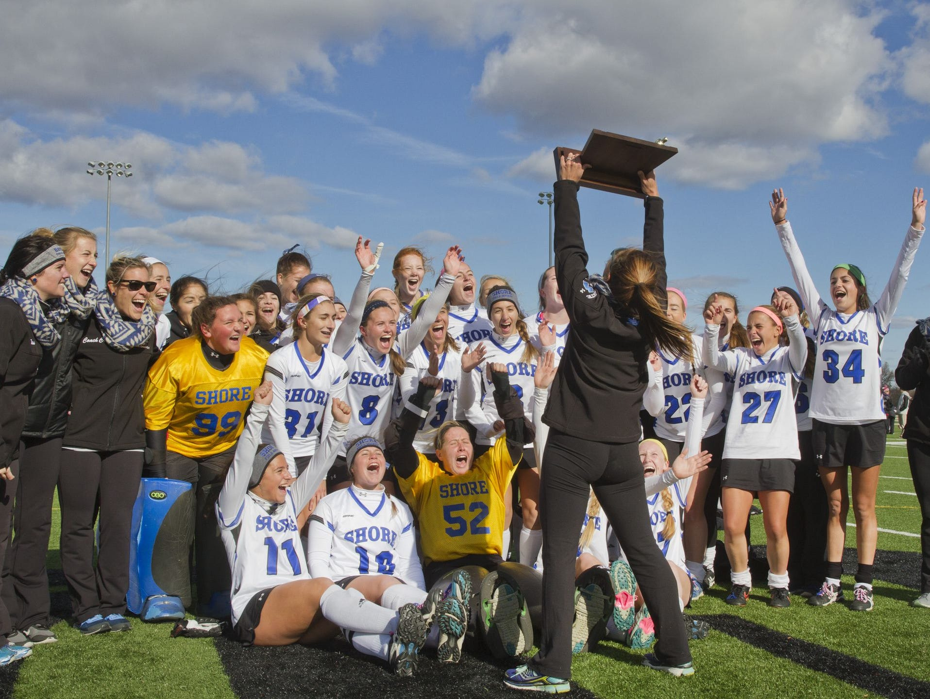 Shore Regional Kelly Koenig displays the NJSIAA Group 1 state title trophy in front of her team after Shore defeated Haddonfield, 3-0, on Nov. 14, 2015 at Bordentown Regional High School