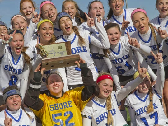 The Shore field hockey teams celebrates after winning the NJSIAA Group 1 state title on Nov. 14, 2015 at Bordentown Regional High School.