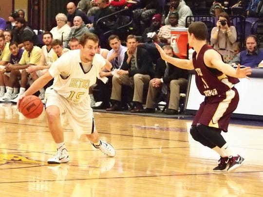 Cole Nelson is back as the starting point guard for the Bethel men's basketball team.