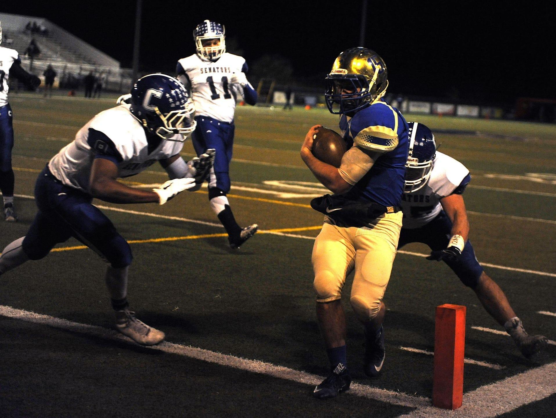 Reed quarterback Matt Denn scores against Carson last week
