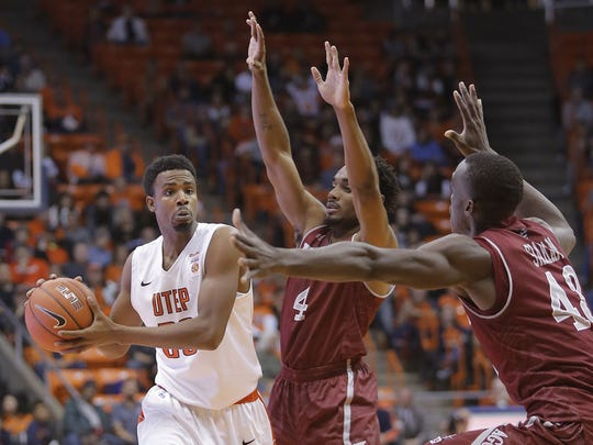 New Mexico State's Pascal Siakam, right, and Ian Baker (4) guard UTEP's Earvin Morris on Dec. 19, 2015, at the Don Haskins Center in El Paso. The Aggies beat the Miners 73-53 to sweep the Battle of I-10 season series.