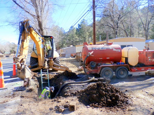 Crews work on a water leak in Ruidoso