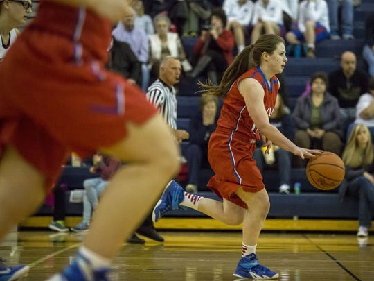St. Clair senior Maddy Gapshes drives the ball down court during a basketball game Wednesday, Feb. 17, 2016 at Marysville High School.