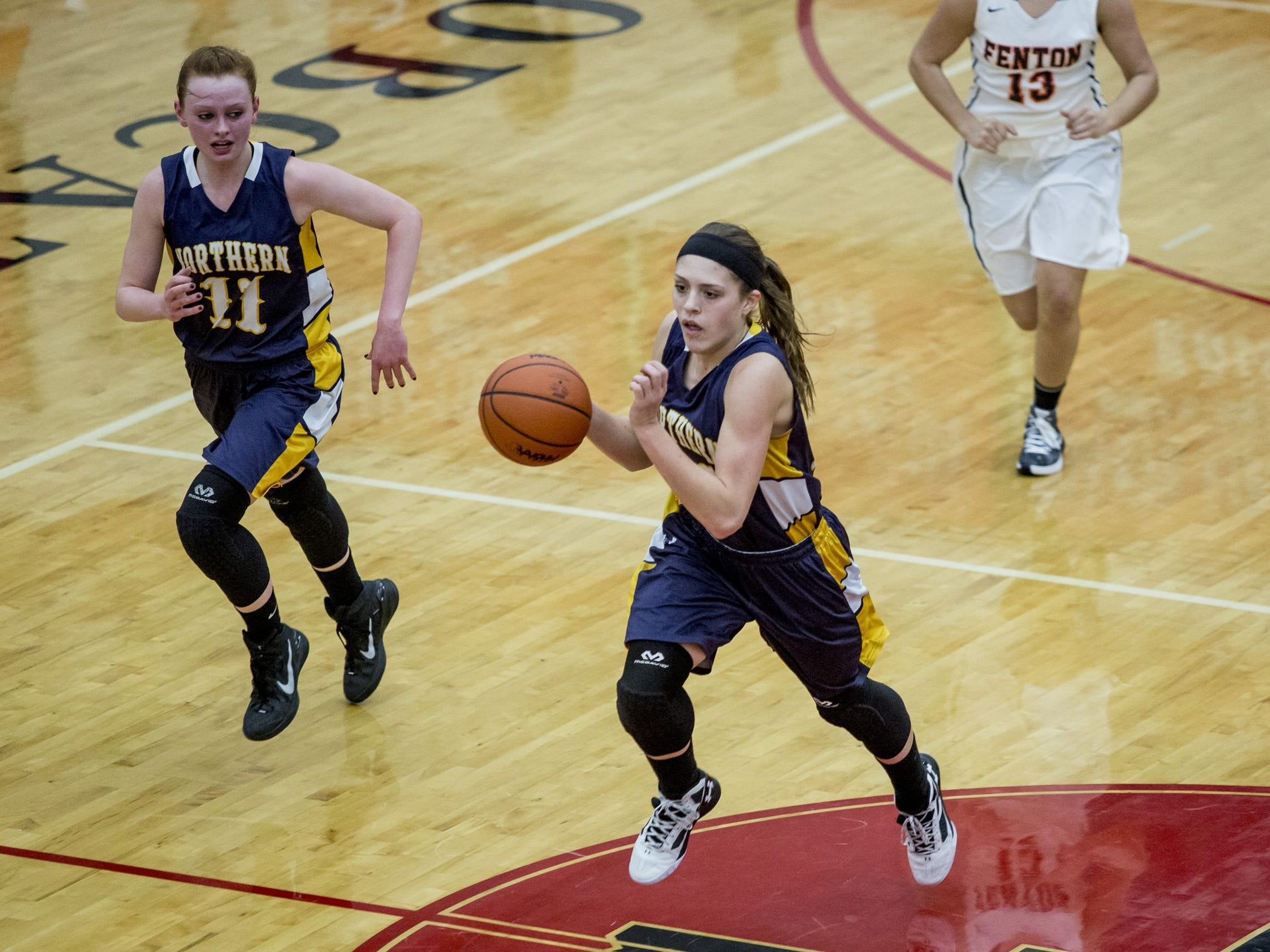 Port Huron Northern senior Kiana Votava breaks away with the ball during a regional final basketball game Thursday, March 10, 2016 at Grand Blanc High School.