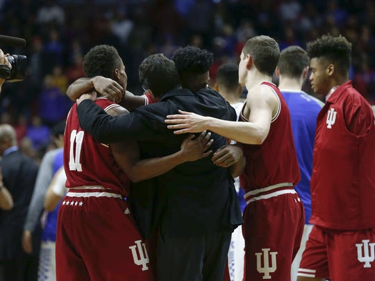 Yogi Ferrell (left), Robert Johnson and Nick Zeisloft embrace Tom Crean after IU's win over Kentucky Saturday.