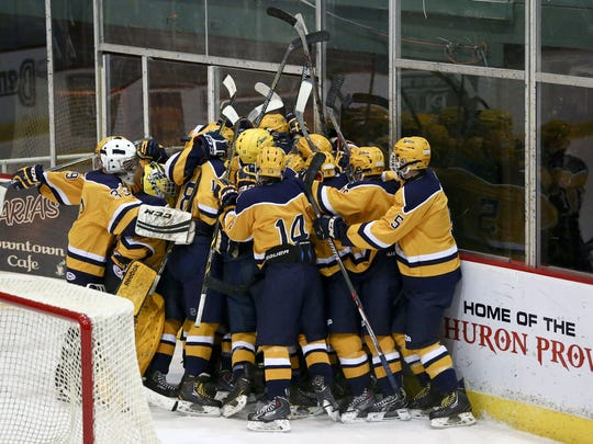 Port Huron Northern players celebrate beating Anchor