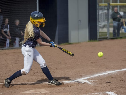 Port Huron Northern's Heidi Wilson gets a hit during