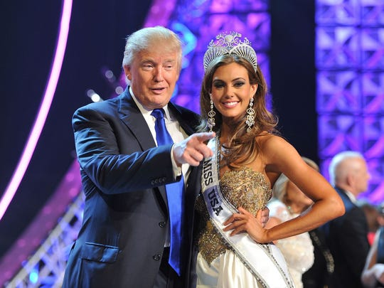 Donald Trump and Miss Connecticut USA Erin Brady pose onstage after Brady won the 2013 Miss USA Pageant, on June 16, 2013.