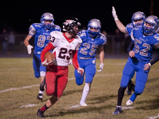 Harley Robinson of Bucyrus carries the ball against