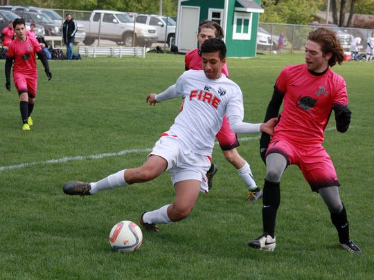 Harman Deol of the BC Fire Soccer Club tries to keep