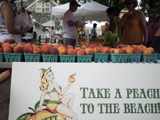Bennett Orchards sells peaches at the Lewes Farmers Market on July 19, 2015.