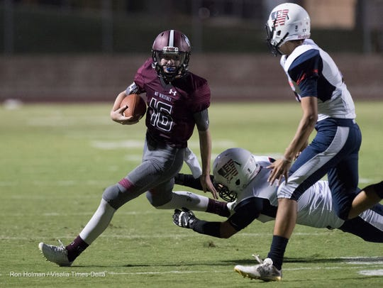 Mt. Whitney's Spencer Tunnell scrambles away from Tulare