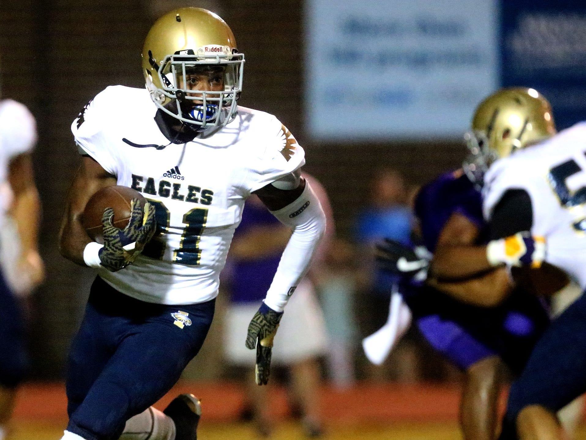 Independence running back Troy Henderson (21).