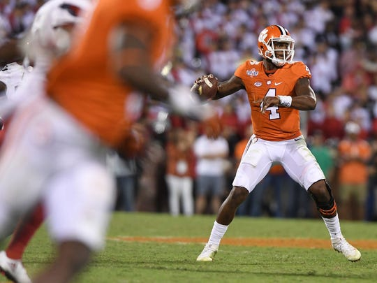 Clemson quarterback Deshaun Watson tossed five touchdown passes in the Tigers' 42-36 win against Louisville.