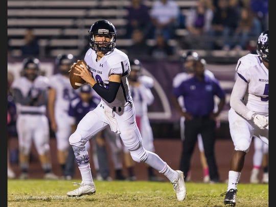 Mission Oak quarterback Matt Bridges scans the field