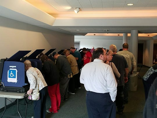 Voters wait to cast ballots at Academy for Innovative Studies