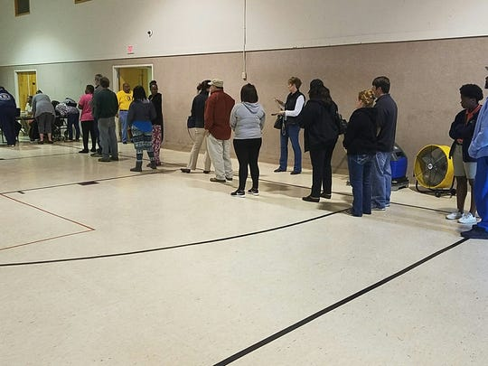 Voters wait in line to cast their ballots at Zion Missionary Baptist Church, Tuesday, November 8, 2016.