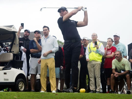 World No. 1 ranked golfer Jason Day (center) played in Jake Owen's group Sunday in the Hale Groves Indian River Grapefruit Pro-Am at Vero Beach Country Club.
