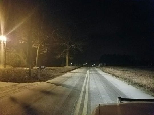 Light snow covered Old Dover Road in Montgomery County Thursday evening.