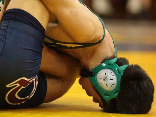 636218545639631600-wrestling-stock-photo.jpg