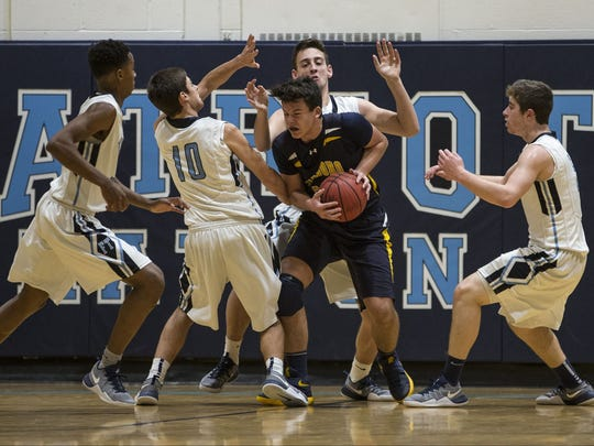 Marlboro's Dylan Kaufman is surrounded by Freehold Township defenders in a game during the 2016-2017 season. FILE PHOTO