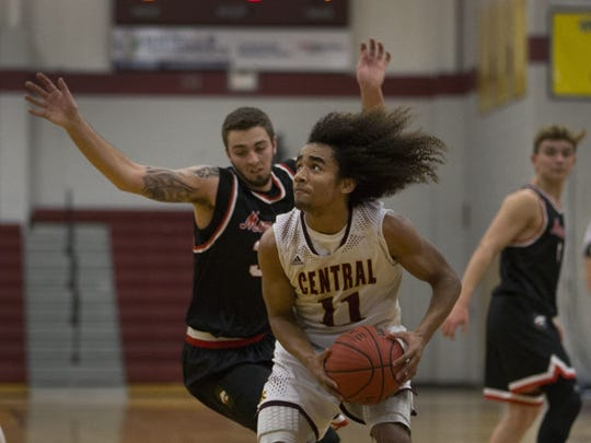 Central Regional's Anthony Holloway (11) goes up for