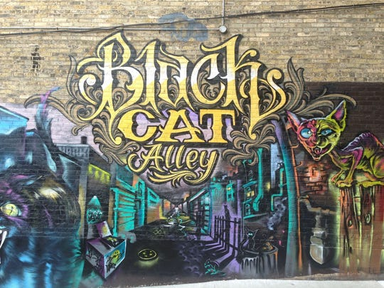 "Black Cat Alley, a collection of street art between East Kenilworth Place and East Ivanhoe Place across from a pair of University of Wisconsin-Milwaukee buildings, is the inspiration for the ""Street Canvas"" project in Bay View. Members of the Walker's Point Artists' Collective painted this mural."