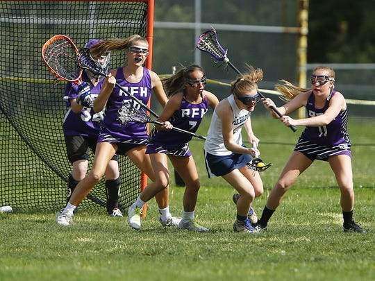 Freehold Township's Michelle Pascrell( #2) controls the ball in front of Rumson-Fair Haven Defenders Meg MacGillis (#7) and Makenna Maguire (#11) during their game at Freehold Township High School Monday, May 1, 2017