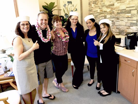 Cruise-Winners-Daniel-and-Susan-Prima-with-Dr.-Rotem-s-Dental-Staff.jpg