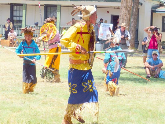 Mescalero Apache dancers entertain on-lookers at Fort