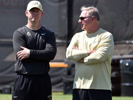 Purdue football coach Jeff Brohm (left) and athletic director Mike Bobinski.