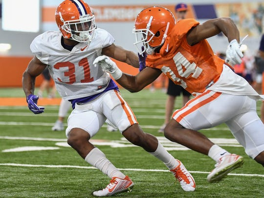 Starting cornerback Ryan Carter (31) covers starting receiver Ray-Ray McCloud (34) during a preseason practice at Clemson's indoor facility.