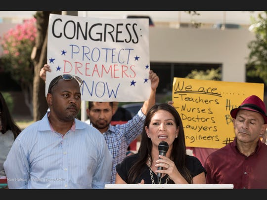 Esmeralda Soria, center, speaks to D.A.C.A supporters gather in front of the Robert E. Coyle United States courthouse in Fresno on Tuesday, Sept. 5, 2017.