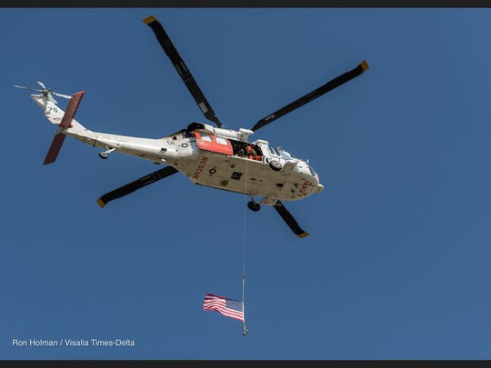 "The ""Wranglers,"" a NAS Lemoore Search and Rescue Unit, provided the flyover for Monday's ceremony to commemorate the Sept. 11 attacks in 2001."