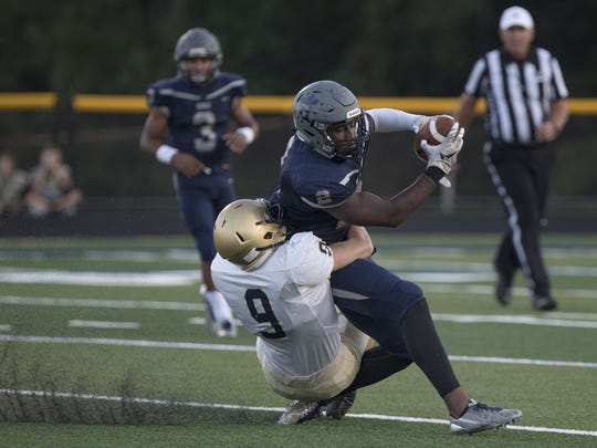 Freehold Boro's Knox Stokes tries unsuccessfully to