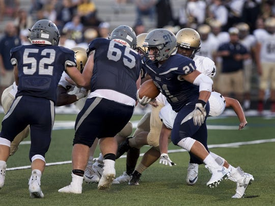 Howell's Nick Chambers gets good blocking as he takes