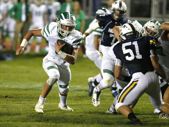 Brick quarterback Jim Leblo rushes for a touchdown