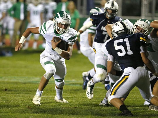 Brick quarterback Jim Leblo rushes for a touchdown against Toms River North high school football game at Brick High School, Brick,NJ. Friday, September 22, 2017.  Noah K. Murray-Correspondent Asb