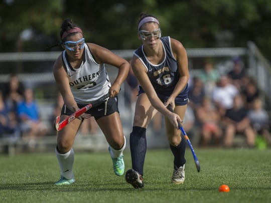 Southern's Ashley Garcia (No. 23) and Toms River North's Ally Mahon (No. 18) battel for the ball. Toms River North vs Southern Regional Girls Lacrosse on September 26, 2017 in Stafford, NJ.   Peter Ackerman