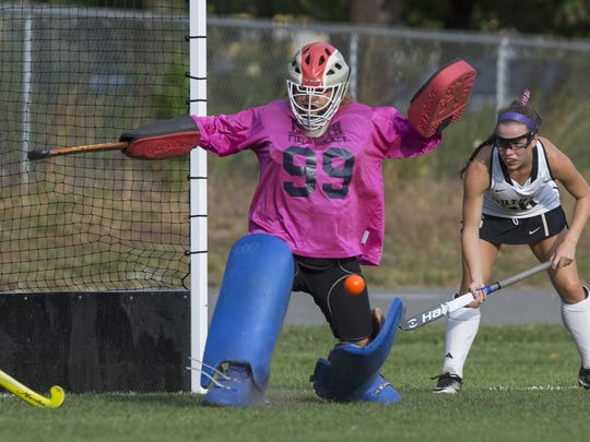 Toms River North goalie Gabby Gibson (No. 99) makes