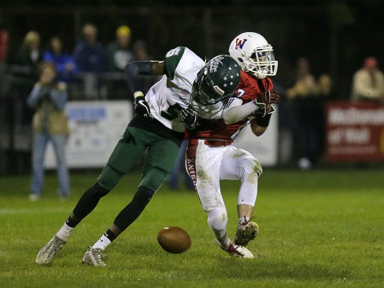 Long Branch's Kevin Porch knocks out a pass intended for Wall's Dylan Richey during the second half of the Long Branch and Wall football game at Wall High School in Wall, NJ Friday, September 29, 2017.  Tanya Breen