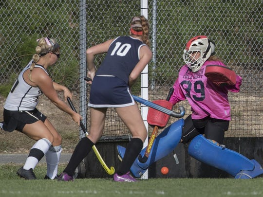 Southern's Samantha Minafo puts in a goal against Toms River North's Gabby Gibson. Toms River North vs Southern Regional Girls Lacrosse on September 26, 2017 in Stafford, NJ.   Peter Ackerman