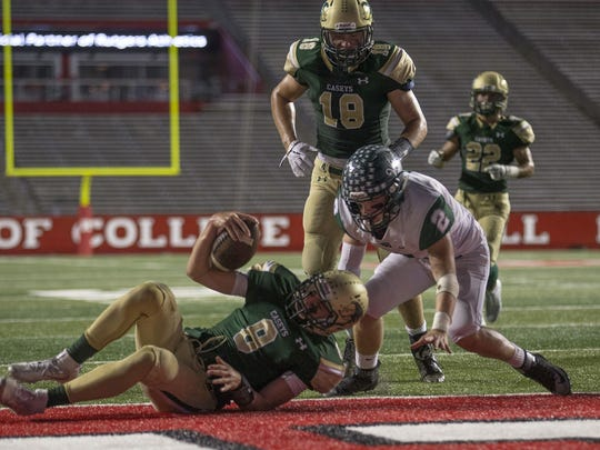 Red Bank Catholic's Steve Lubischer takes the ball around right end, evades tacklers and flips in for a first half touchdown. Red Bank Catholic vs Long Branch Football at Rutgers University on October 14, 2017.   Peter Ackerman
