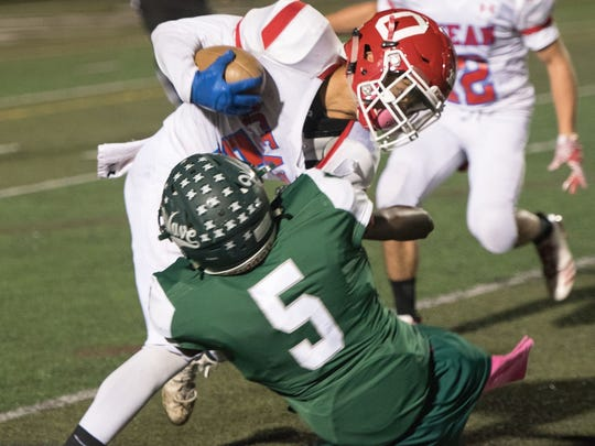 Kevin Porch (5) of Long Branch tackles Ocean's Alex Bryant. Long Branch hosted Ocean Twp in football on Friday, October 20, 2017. /Russ DeSantis for the Asbury Park Press / Slug:  Russ DeSantis, Russ DeSantis