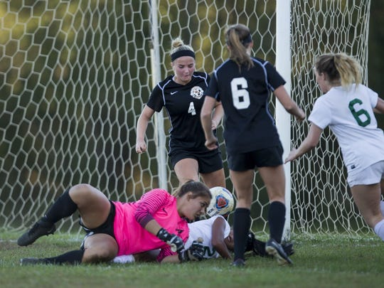 Middletown North goalie Haley Martin and Colts Neck's Kayla Lee battle on ground for loose ball during second half action. Colts Neck Girls Soccer defeats Middletown North on October 19, 2017 in Colts Neck, NJ.   Peter Ackerman