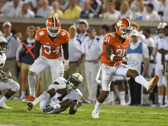 Clemson's Ryan Carter (31) and Kendall Joseph (34) helped limit Georgia Tech to only 71 rushing yards in the Tigers' win in Atlanta last season.